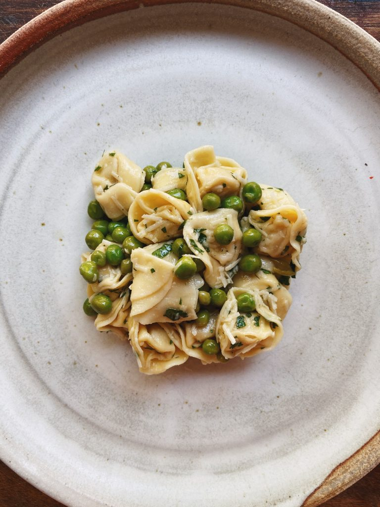tortellini and green pea salad on a plate